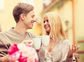 summer holidays, love, travel, tourism, relationship and dating concept - romantic happy couple in t