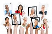 Variation of hands holding digital tablets with multi ethnic people thinking of inspiration.