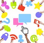 Hands Holding Social Networking Concept Symbols and Speech Bubble