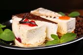 Assortment of pieces of cake, on dark background