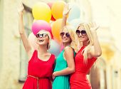 holidays and tourism, friends, hen party, blonde girls concept - three beautiful women with colorful