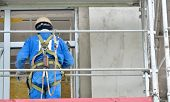stock photo of harness  - construction worker in scaffold - JPG