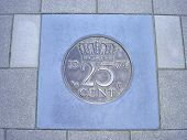 Coin Of Twenty-five Cents In Pavement