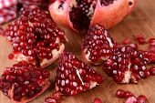 Ripe pomegranates on table close-up