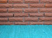 Brick wall and blue carpet at home