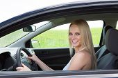 Happy Young Beautiful Woman Driving Car