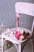 Beautiful wedding still life with bouquet on wooden chair