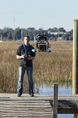 man flying unmanned drone with video camera