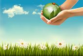 Nature background with hands holding a globe.  Raster version