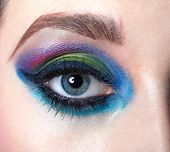 Closeup female eye with beautiful fashion bright makeup