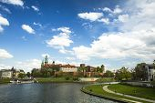 KRAKOW, POLAND - APR 21, 2014: View of Royal Wawel castle with park. The monument to the history of