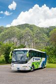 VINALES, CUBA - APRIL 15, 2014: Tour bus at the Vinales Valley in Cuba, a famous touristic landmark