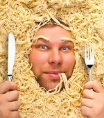 Man's face in pasta, closeup