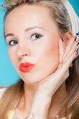 stock photo of flirty  - Portrait beautiful young blonde woman in pin - JPG