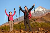 Success winning celebrating hiking people at top. Cheering hiker couple enjoying freedom on hike wit