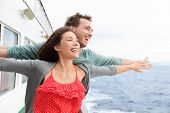 Romantic couple having fun laughing in funny pose on cruise ship boat. Smiling happy man and woman o