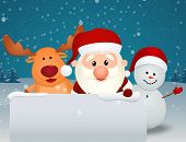 santa claus with reindeer and snowman in winter landscape
