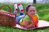 Little smiling girl at picnic