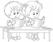 stock photo of first class  - Schoolgirl and schoolboy reading books at their desk in a classroom - JPG