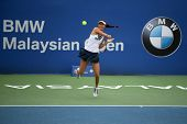 KUALA LUMPUR - APRIL 20, 2014: Chan Hao-Ching of Taiwan returns at the doubles final of the BMW Mala