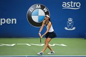 KUALA LUMPUR - APRIL 20, 2014: Chan Hao-Ching of Taiwan serves at the doubles final of the BMW Malay