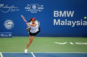 KUALA LUMPUR - APRIL 20, 2014: Chan Yung-Jan of Taiwan returns at the doubles final of the BMW Malay