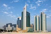 DOHA, QATAR - NOVEMBER 18, 2007: The commercial district of Doha with a sparse scattering of new-bui