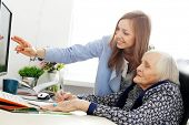 Elderly woman and beautiful teacher