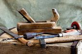 image of auger  - still life with old hammer and carpentry tools