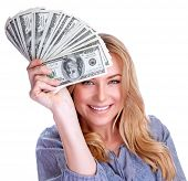 Portrait of attractive cheerful female showing many banknotes of one hundred dollars, isolated on wh