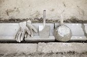 image of mason  - Mason tools for curb stone installing trowel. gloves
