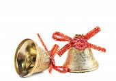 Christmas jingle bells with red ribbon.