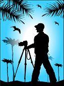 Photographer's Silhouette Against The Blue Sky