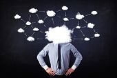 Business man with cloud network head on grungy background