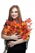 Smiling young woman with autumn maple leaves