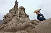 Sandsculpture artists working on his sculpture