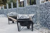 wheelbarrows full with gravel