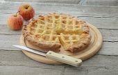 Apple pie with knife and apples