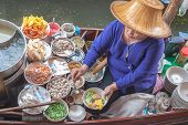 A Woman Makes Nooddle Thai Food At Damnoen Saduak Floating Market