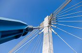 Modern Cable Bridge Pylon Against Blue Sky