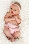 Newborn baby girl with eyes open