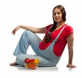 Pregnant Woman With Vegetables And Fruits