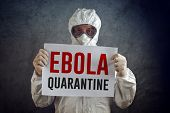 image of hemorrhage  - Ebola Quarantine sign held by medical healh care worker wearing protective gown glowes mask and goggles - JPG
