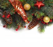 Christmas background. Christmas boarder with fir tree branch with cones and ornament. Christmas baubles in golden and red colour. Close up with copy space. Winter holidays concept.