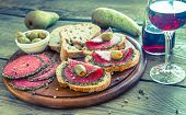 Sandwiches With Italian Salami And Wine
