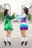 Two Women In Irish Dance Dresses Posing
