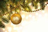 Closeup on Christmas tree decoration over festive background