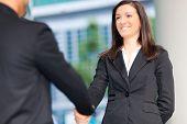 Business people shaking hands outdoor