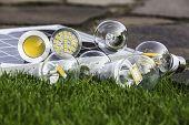 Various Bulbs E27, Gu10  And Solar Panel On The Grass
