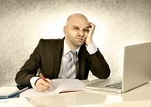 Young Bald Attractive Business Man Bored With Computer At Work